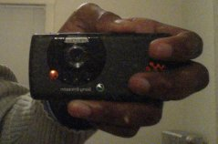 A picture of the Sony Ericsson w810i, as seen in the mirror.