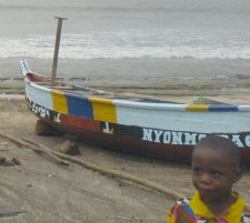A fishing boat and a young girl. Taken in a Ghanaian fishing village.